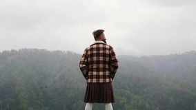 Man kilt with mustache beard mountain. Looking back. Snow. Fog caucasian stock footage