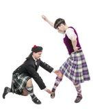 Man in kilt teaching woman Scottish dance Stock Photography