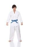 Man in a kimono. Karate. Man in a kimono , isolated on the white background Royalty Free Stock Photography
