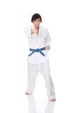Man in a kimono. Karate. Man in a kimono , isolated on the white background Royalty Free Stock Photos