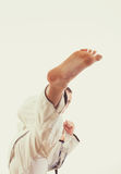 Man in kimono beat a high leg kick Stock Photo