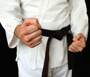 Man in a kimono and belt for martial arts Stock Photos