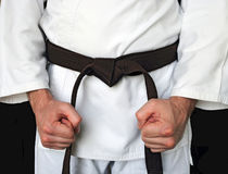Man in a kimono and belt for martial arts royalty free stock images