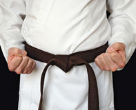 Man in a kimono and belt for martial arts Royalty Free Stock Photo