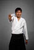 Man in kimono with business card Royalty Free Stock Image
