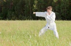 Man in kimono engaged oriental combat sports Stock Photos