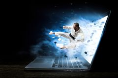 Man in kimono and glowing laptop. Mixed media Stock Images