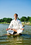 Man in kimono meditating Royalty Free Stock Image