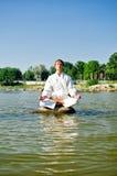 Man in kimono meditating Royalty Free Stock Images