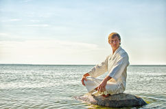 Man in kimono meditating Stock Photography
