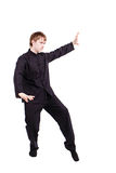 Man in a kimono practicing kung fu Stock Images