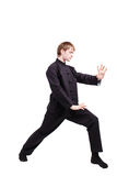 Man in a kimono practicing kung fu Stock Photography