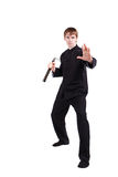 Man in a kimono practicing kung fu with nunchaku. The man in a kimono practicing kung fu. Master holding nunchuck. Fighter isolated on white background. Concept Royalty Free Stock Photos