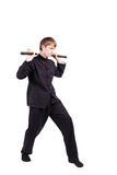 Man in a kimono practicing kung fu with nunchaku. The man in a kimono practicing kung fu. The wizard displays a nunchaku kata. Fighter isolated on white Stock Photography