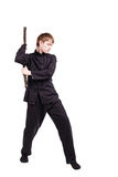 Man in a kimono practicing kung fu with nunchaku. The man in a kimono practicing kung fu. The wizard displays a nunchaku kata. Fighter isolated on white Royalty Free Stock Photo