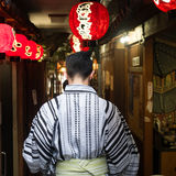 Man in Kimono. A tourist in Kimono walking through a laneway in Osaka Royalty Free Stock Photo
