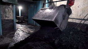 Man kindles fire in the furnace. stock video footage