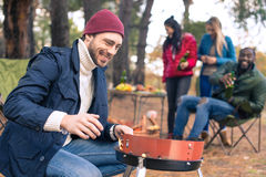 Man kindling fire on grill royalty free stock photography