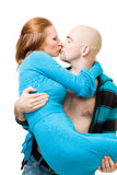 Man kiss and carry woman. Young bold man kiss and carry woman, isolated on white Stock Photography
