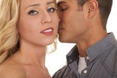 Man kiss womans cheek close she look Royalty Free Stock Images