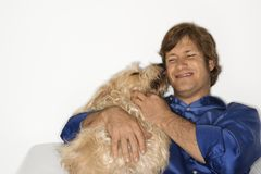 Man kissed by brown dog. Stock Image
