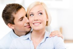 Man kisses blonde woman Royalty Free Stock Image
