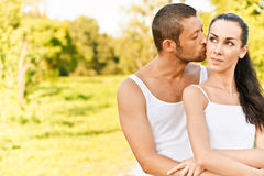Man kisses in on cheek woman Royalty Free Stock Image