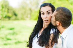 Man kisses in on cheek woman Stock Photography