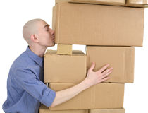 Man kisses heap cardboard boxes. On white royalty free stock images