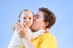 Man kisses his daughter Stock Image