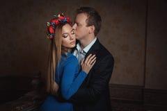 Man kisses a woman. Stock Photos