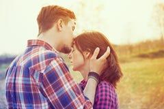Man kisses a woman Stock Photography