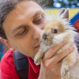 Man kissing the baby rabbit. Animal care Stock Photos
