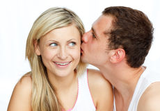 Man kissing a beautiful woman Stock Images