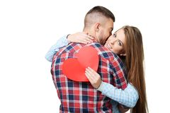 Man kissing beautiful woman with heart card Royalty Free Stock Photography