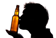 Man kissing bottle of cider Royalty Free Stock Images