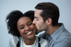 Man kissing on the cheek of woman. Close-up of man kissing on the cheek of woman Stock Photos