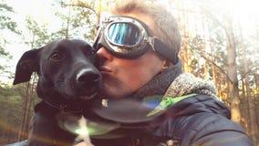 Man kissing dog Royalty Free Stock Photos