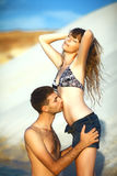 Man kissing girl on beach. Inlove couple on travel honeymoon vacation summer holidays romance. Young happy girl and men kissing and hugging on ocean shore Royalty Free Stock Photo