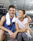 Man kissing girlfriend at the gym Royalty Free Stock Images