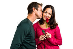 Man kissing girlfriend. While standing on white background stock image