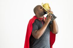 Man kissing the golden trophy winning and victory concept Stock Image