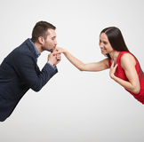 Man kissing hand of beautiful woman Stock Photo