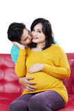 Man kissing his beloved pregnant wife Stock Photo
