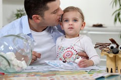 Man kissing his daughter. Man kissing his little daughter Stock Images