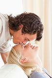 Man kissing his fiance on the forehead Royalty Free Stock Photo
