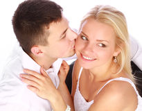Man kissing his girlfriend Stock Image