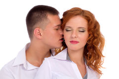 Man kissing his girlfriend Royalty Free Stock Image