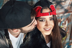 Man kissing his girlfriend on the cheek Royalty Free Stock Image