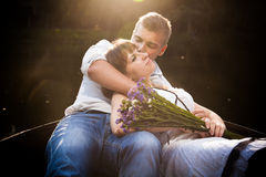 Man kissing his girlfriend on rowing boat Stock Image